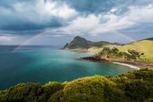 Rainbow Arching Against Storm Clouds Gathering Over Coastline OfCoromandelPeninsula