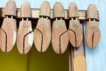 Wooden Shoe Stretchers Hanging In Workshop