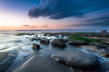 New Zealand, South Island, Rocky Coast At Sunset
