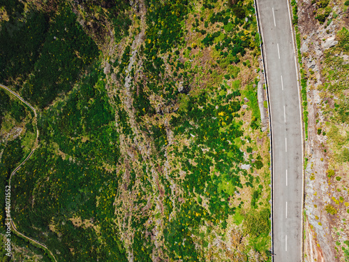 Tablou Canvas Aerial view of a highway amid the beautiful, green canyons