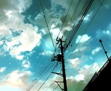 Power Lines's Silhouette And Beautiful Clouds In The City Landscape