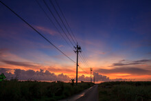 A Magical And Beautiful Dusk Cloud Upon A Country Road With Many Telephone Poles
