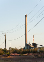 Smoke Stacks And Power Lines In A Mining Town
