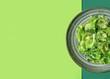 Leinwandbild Motiv Plate with fresh salad on color background