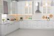 Leinwandbild Motiv Light kitchen interior with stylish furniture and modern equipment
