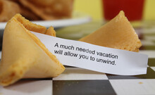 Fortune Cookie On Table A Much Needed Vacation Will Allow You To Unwind