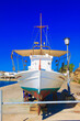 Leinwandbild Motiv Beautiful colorful fishing boat in Mykonos Island Greece