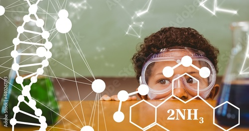 Composition of dna strand and elemental diagrams over child wearing safety glasses in science class
