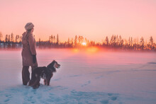 Woman With Dog At Winter