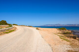 Fototapeta Kwiaty - The road on the seafront in the northeast of the island of Paros. Cyclades, Greece