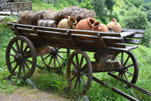 Old Wooden Cart With Clay Jugs