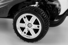 Close Up Of A Scale Model Wheel Of A Sportive Car. Rim And Tire Of A Model Racing Sports Car.