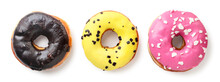 Three Donuts Close-up On A White Background. Top View.