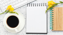 Office Workplace Background With Notepad For Writing, White Keyboard, Cup Of Fresh Coffee And Yellow Alstroemeria Flowers, Summer Mood Workplace