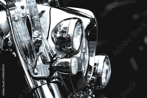 Fotografiet Chrome headlights of a classic chopper motorbike in black and white