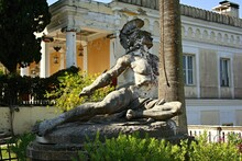 Statue Of The Dying Achilles With An Arrow In His Heel. Achillion Palace In Corfu, Greece