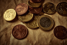 Vintage Background With Different Euro Coins On Aged Paper