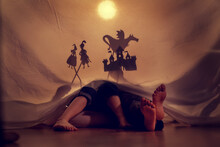 Small Children Play In The Shadow Theater. Theatre. Childhood. Fairy Tale.