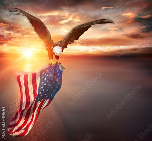 Fotografie, Obraz Eagle With American Flag Flies In Freedom At Sunset - Vintage Toned