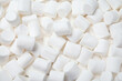 canvas print picture - Delicious white puffy marshmallows as background, top view
