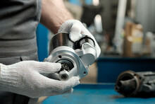 Spare Parts.The Car Starter Is In The Hands Of An Auto Mechanic.Installing A New And Replacing A Faulty Starter.Maintenance And Repair Of The Car In The Service Center.