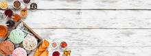 Summer Ice Cream Bar With Assorted Ice Cream Flavors And Tasty Toppings. Top View Corner Border Over A Rustic White Wood Banner Background.