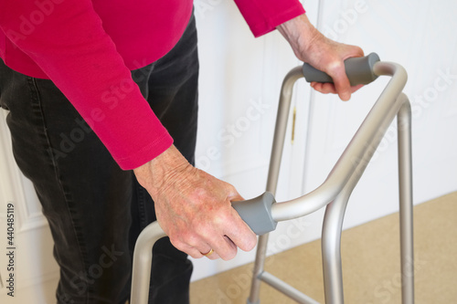 Foto Old person with walking frame inside house