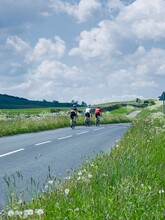 A Group Of Cyclists Ride Through The Yorkshire Dales Near Middleham Gallops In Wensleydale, North Yorkshire.
