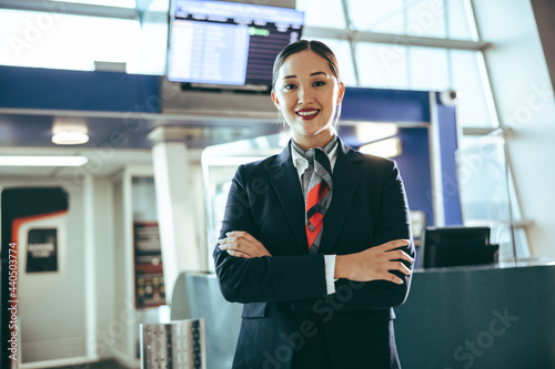 Obraz na plátne Confident flight attendant at international airport