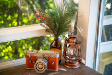 The Antique, Vintage And Loft Decoration Style By Utilise The Vintage Toy Camera, Lamp And Brown Bottle With Planting. Concept For Cafe Decorative, Terrace, Cozy, Minimal And Urban Living.