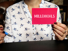 Business Concept About MILLENNIALS With Phrase On The Sheet. Generation Yor Gen Y, Are ThedemographiccohortfollowingGeneration Xand PrecedingGeneration Z.