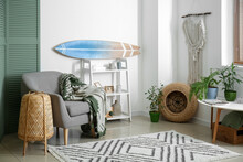 Interior Of Modern Stylish Room With Surfboard And Armchair