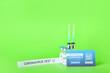 Leinwandbild Motiv International Certificate of Vaccination and covid-19 vaccine on color background