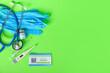 Leinwandbild Motiv Immune card, stethoscope, medical gloves and covid-19 vaccine on color background