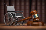 Disability law and social services for disabled people concept. Wheelchair and gavel.