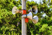 Loudspeakers Megaphones On The Electric Pole. Public Address System