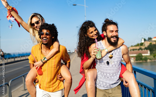 Group of happy friends drinking outdoors before festival Fototapet