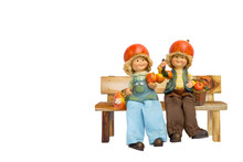 Cute Little Apple Boy And Girl Doll Sitting On Wood Bench Isolate On White Background