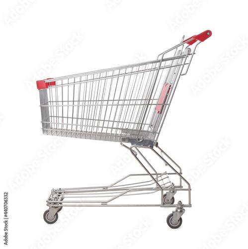 Fototapeta Empty metal shopping cart isolated on white