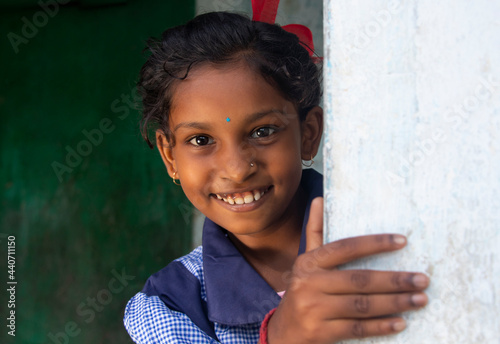 Fototapeta Close-up portrait of a rural school girl Catching a wall