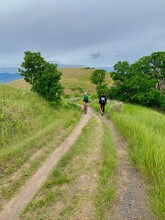 Fitness For Two, Man On Bicycle And Hiker