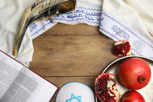 Frame Of Rosh Hashanah Holiday Attributes On Wooden Table, Flat Lay. Space For Text