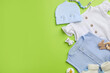 Leinwandbild Motiv Flat lay composition with baby clothes and accessories on green background, space for text