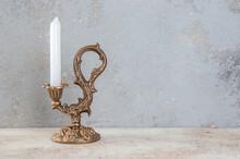 Antique Candlestick On Concrete Background