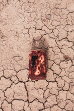 Old Rusty Can On The Dessert Ground, Global Warming
