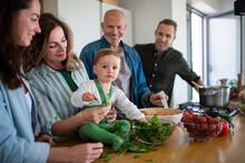 Happy Multigeneration Family Indoors At Home Preparing Vegetable Salad.