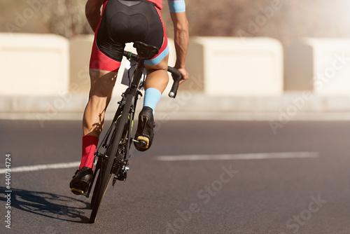Fototapeta Road bike cyclist man cycling, athlete on a race cycle