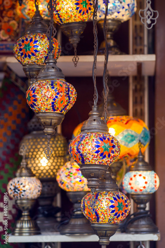 Obraz na plátne Middle Eastern lambas of different colors and sizes are hanging in the bazaar