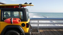 Yellow Lifeguard Car, San Clemente Beach Pier, California USA. Coastline Rescue Life Guard Pick Up Truck, Lifesavers Vehicle. Auto And Ocean Coast. Los Angeles Vibes, Summertime Aesthetic Atmosphere.