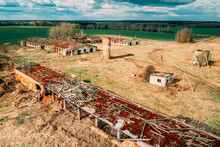 Belarus. Abandoned Barn, Shed, Cowsheds, Farm House In Chernobyl Resettlement Zone. Chornobyl Catastrophe Disasters. Dilapidated House In Belarusian Village. Whole Villages Must Be Disposed
